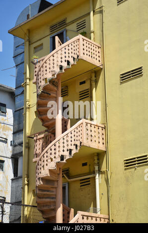 Colorful spiral staircases at the back of traditional chinese shop houses in singapore - Stock Photo