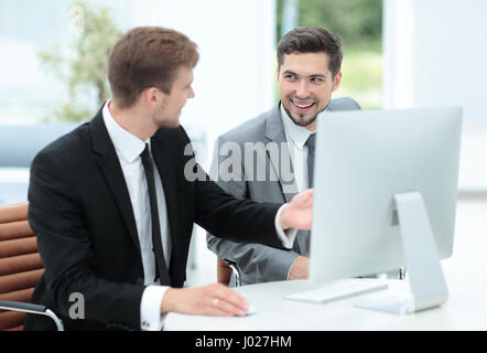 Two successful business men discussing documents in a modern off - Stock Photo