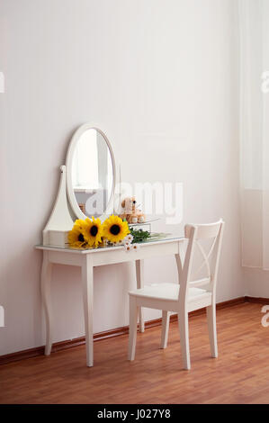 A white dressing table, glass mirror - Stock Photo