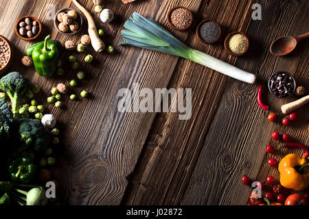 Different vegetables and spices in bowls. Wooden table, top view. - Stock Photo