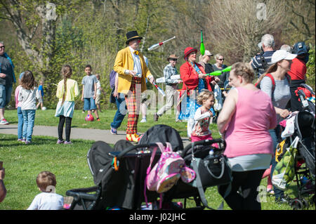 Juggling clowns parade through Hotham Park in Bognor Regis, England during the International Clown Festival. - Stock Photo