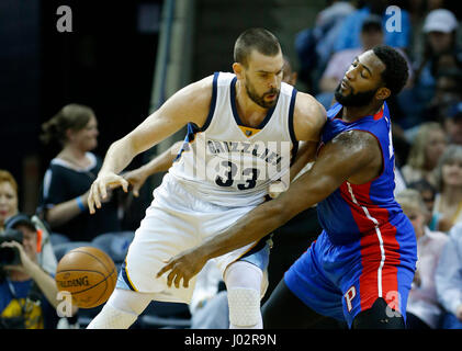 Detroit Pistons center Andre Drummond (R) knocks the ball away from Memphis Grizzlies center Marc Gasol, of Spain, - Stock Photo