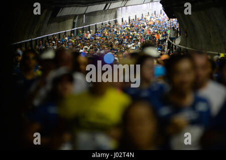 Sao Paulo, Brazil. 9th April, 2017. Marathoners pass through the tunnel Court of Justice, during the 23rd International - Stock Photo