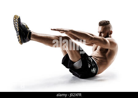 Handsome young man doing fitness exercise. Photo of muscular man in silhouette on white background.  Fitness and - Stock Photo
