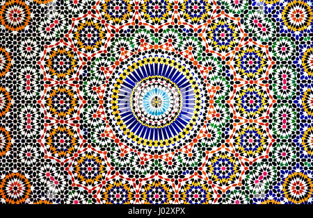 The colourful geometric patterns of an Islamic mosaic decorate the walls the Kasbah Telouet, a crumbling palace - Stock Photo