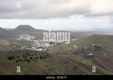 View of Haria from Mirador de Haría in Lanzarote on a cloudy  winter day. This town is famous for being shaped like - Stock Photo