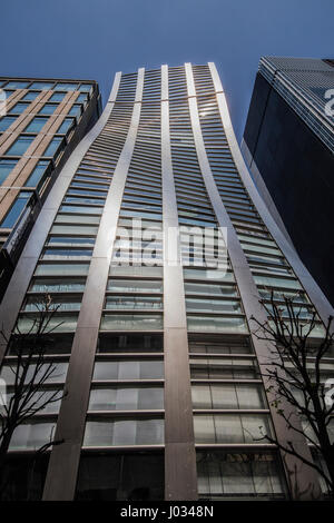 Ginza De Beers Building - Ginza is known as an upscale area of Tokyo with numerous department stores, boutiques, - Stock Photo
