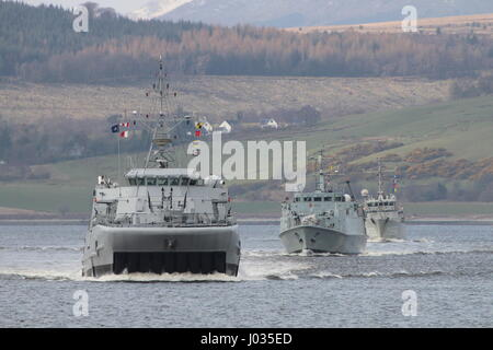 KNM Hinnoy (M343), leads HMS Ramsey (M110) and HNLMS Schiedam (M860) as they pass Greenock on their arrival for - Stock Photo