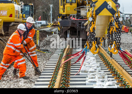Rail construction workers installing new tracks and points - Stock Photo