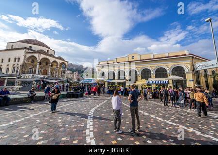People on Monastiraki Square in Athens city, Greece. View with 18th century Tzistarakis Mosque building - Stock Photo