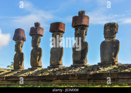Moai statues standing on Anakena Beach in Easter Island, Chile - Stock Photo