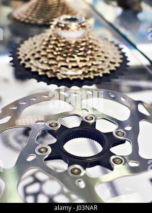 Disk brake and rear cassette stars of speeds in storefront of shop - Stock Photo