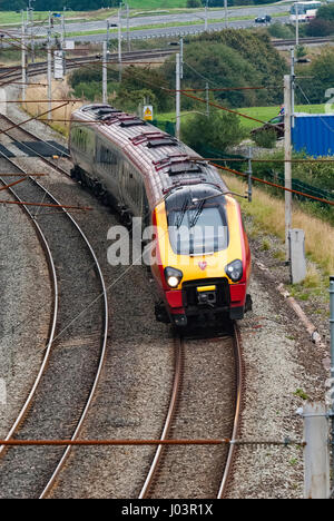 Virgin passenger train on the West Coast Main Line in Cumbria. Voyager. - Stock Photo