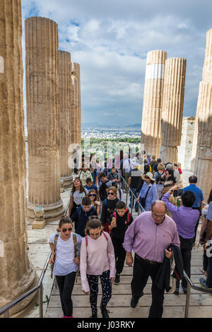 Colonnades of monumental gateway called Propylaea, entrance to the top of Acropolis of Athens city, Greece - Stock Photo