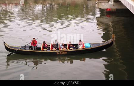 KAOHSIUNG, TAIWAN -- FEBRUARY 22, 2015: Tourists enjoy a ride on the Love River in a boat that resembles a Venetian - Stock Photo