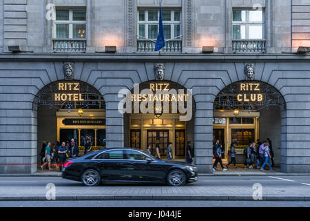 A luxury car passes the entrance to the Ritz Restaurant at 150 Piccadilly, St Jame's London - England. - Stock Photo