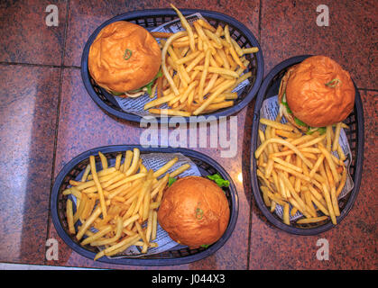 3 beef chicken and vegetarian Burgers on the basket - Stock Photo