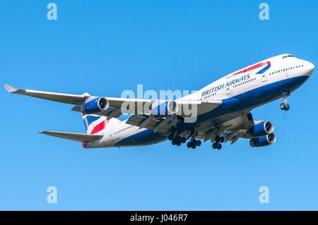 London, UK, April 9 2011: 4-engines Boeing 747 'queen of sky' of British Airways carrier landing at Heathrow airport. - Stock Photo