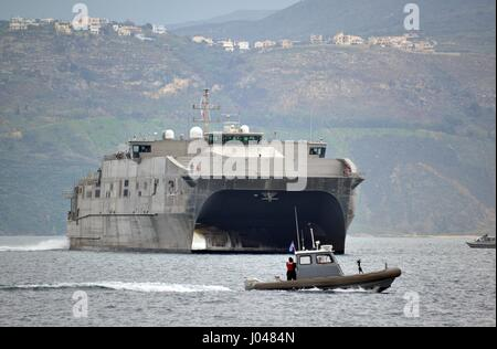 The USN Spearhead-class expeditionary fast transport vessel USNS Spearhead arrives in port February 5, 2014 in Souda - Stock Photo