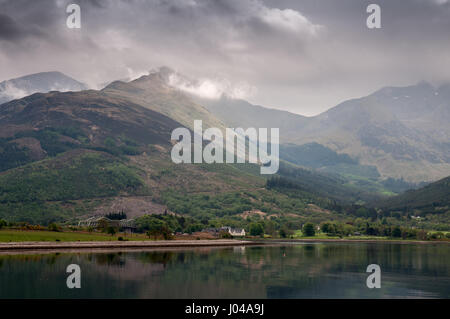 The Ballachulish Bridge and hotel are nestled on the shore of Loch Linnhe sea inlet under the steep mountains of - Stock Photo