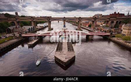 Newcastle, England - May 27, 2011: A Northern Rail Class 142 Pacer train on the High Level Bridge over the River - Stock Photo