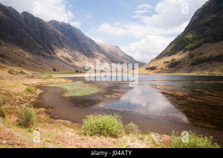 Climbing the Pass of Glen Coe from Glencoe village to Rannoch Moor on a spring day. - Stock Photo