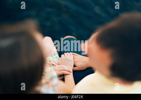 Newlyweds hold hands on the sea. Couple holding hands. Wedding i - Stock Photo