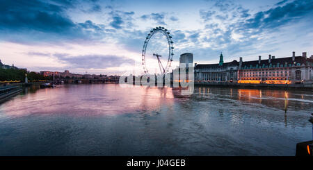 London, England - June 15, 2011: Sunrise behind the London Eye observation wheel on a summer morning, seen from - Stock Photo