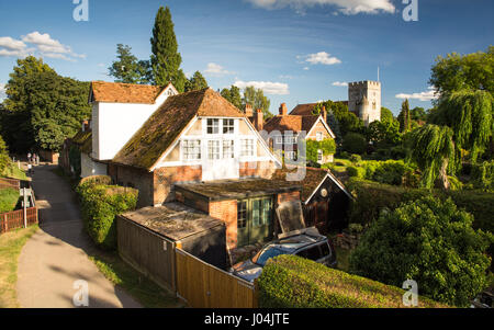 Reading, England, UK - August 29, 2016: Traditional cottages and parish church beside the River Thames in the village - Stock Photo