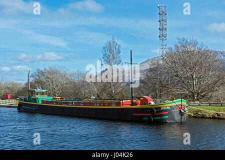 Barge Fingal moored in the Union Canal basin at Banavie near Fort William in Highland Scotland UK - Stock Photo