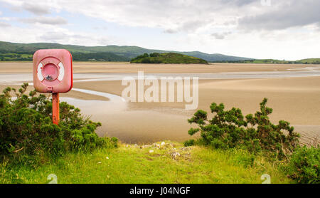Sandy beaches are exposed at low tide in the estuary of the Afon Dwyryd near Portmeirion in the Snowdonia National - Stock Photo