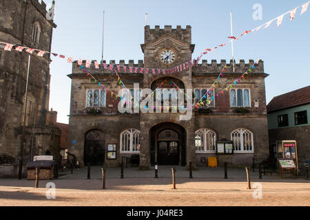 Shaftesbury, England, UK - June 28, 2012: Bunting decorates the castellated stone town hall of Shaftesbury in Dorset - Stock Photo