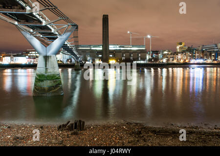 London, England - December 2, 2010: The Millennium Bridge and Tate Modern seen from the banks of the River Thames - Stock Photo