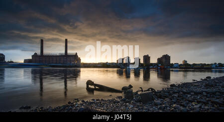 Sunset over Chelsea's World's End Estate and Lots Road Power Station from Battersea Riverside across the Thames. - Stock Photo