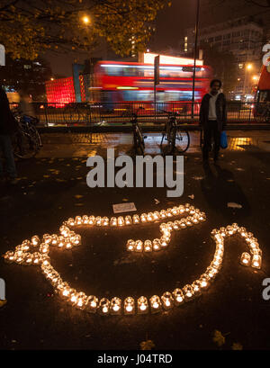 London, England, UK - November 16, 2012: Candles are arranged into the dove logo of the Roadpeace campaign group - Stock Photo