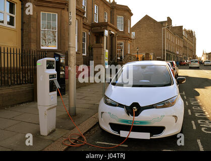 An electric car, from the city's Car Club scheme, being charged on Perth Road, Dundee - Stock Photo