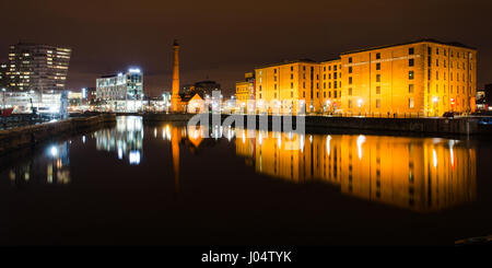 Liverpool, England, UK - November 4, 2014: The pump house and warehouses of the historic Albert Dock complex are - Stock Photo