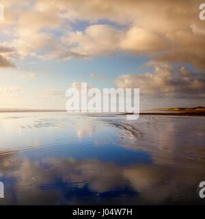 The vast emptiness of Ninety Mile Beach, Northland, New Zealand, at sunset. - Stock Photo