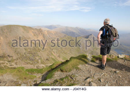 Embargoed to 0001 Tuesday April 11 File photo dated 30/09/11 of a walker looking out at the summit of Snowdon in - Stock Photo