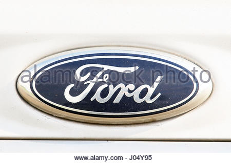 Embargoed to 0001 Tuesday April 11 File photo dated 13/09/11 of a Ford logo on a car, as the company is motoring - Stock Photo