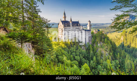 Neuschwanstein Castle, the 19th century Romanesque Revival palace built for King Ludwig II, in beautiful evening - Stock Photo