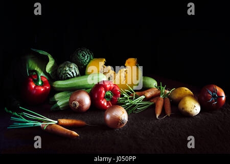 Collection of fresh vegetables on dark rustic background. Healthy eating concept. Vegan dinner - Stock Photo