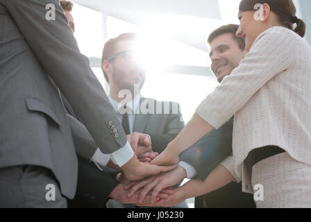 Business people join hand together during their meeting - Stock Photo