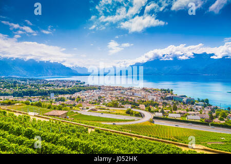 Aerial panoramic view of the city of Vevey at Lake Geneva with vineyards of famous Lavaux wine region on a beautiful - Stock Photo