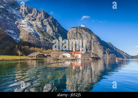 Beautiful view of scenic mountain scenery with Lake Konigssee with famous Sankt Bartholomae pilgrimage church and - Stock Photo