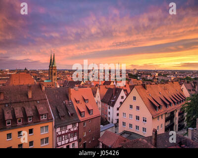Panoramic view of the historic city of Nuremberg illuminated in beautiful golden evening light with dramatic clouds - Stock Photo