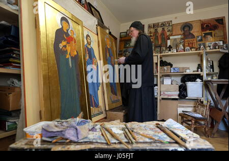 KOZELSK, KALUGA REGION, RUSSIA - MARCH 16, 2017: An icon painter in the St. John the Baptist skete at the Optina - Stock Photo
