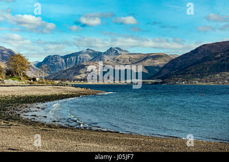 View from Scottish village Onich across Loch Linnhe towards the Glen Coe mountains with Bidean nam Bian in Highland - Stock Photo