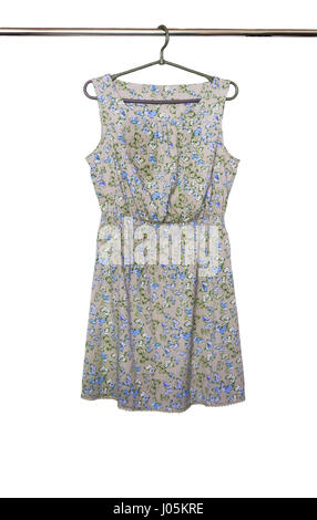 Summer dress with a butterfly pattern hanging on a hanger, isolated - Stock Photo