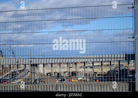 Aerial view of the Turcot project behind the fence., The interchange is a hub for road traffic in Montreal interconnecting - Stock Photo
